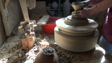 Turning pottery wheel to make ceramics artefact Footage