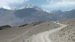 Toyota Landcruiser drives through mountains Tajiki Footage