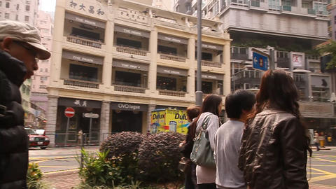 a daytime street scene from Hong Kong island Live Action