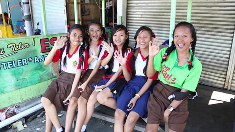 a group a young school girls in bali Footage