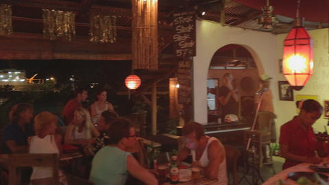 The Nightlife Scene In Labuan Bajo At A Restaurant stock footage