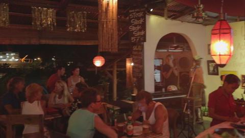 the nightlife scene in labuan bajo at a restaurant Live Action