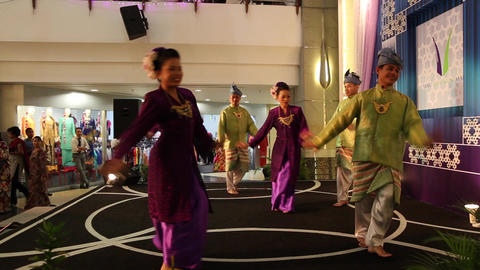 Malaysian dancers perform close side angle Live Action