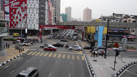 a wide shot of traffic waiting at a busy Kuala lum Footage