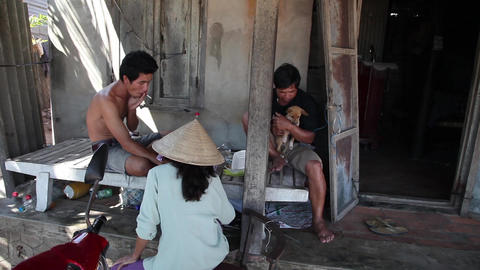 People Sitting At Home. Vietnam stock footage