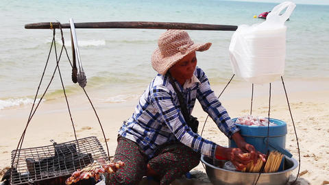 Asia, a woman prepares squid Footage