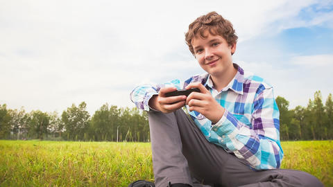 Young Man Communicates on the Smartphone Footage