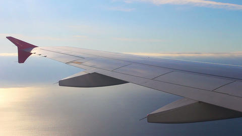 looking on wing and sea from airplane Footage