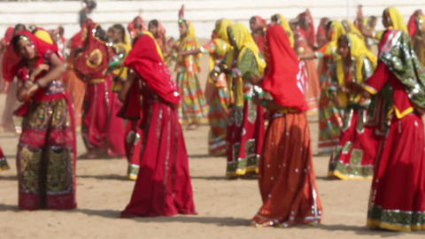 Indian girls in colorful ethnic attire dancing at  Footage