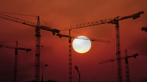 Construction Cranes Working On Background Of Setti stock footage