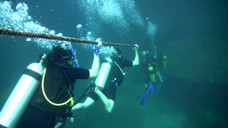 Divers Going Down A Line stock footage