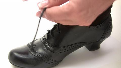 Tying a Black Shoe Footage