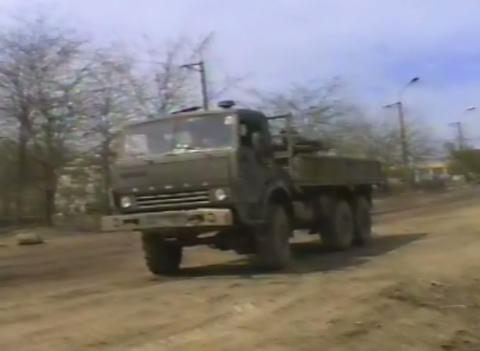 Military vehicles at the front. Grozny, the ruined Footage