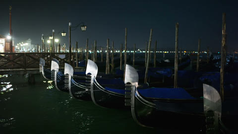 Venetian Gondolas Tied Near The Pier At Night On S stock footage