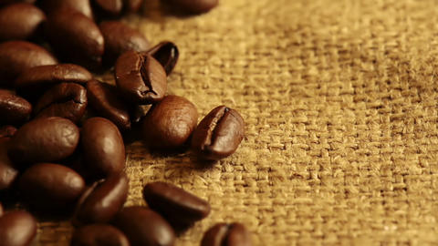 Burlap Fabric and Coffee Beans. Macro Footage