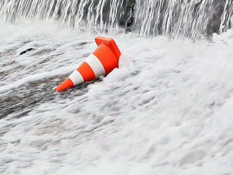 Water flows on the orange traffic cone. 640x480 Footage