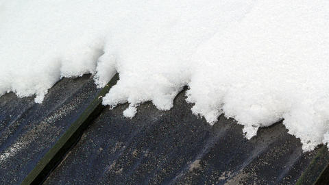 On a black roof snow melts. Time Lapse. 1280x720 Footage