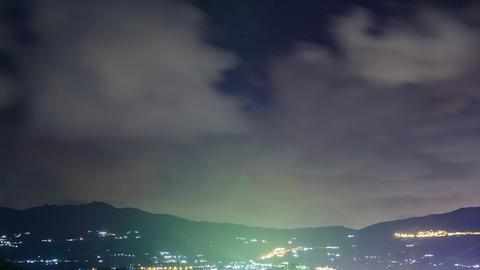 Clouds over the mountains at night. Time Lapse . 4 Footage