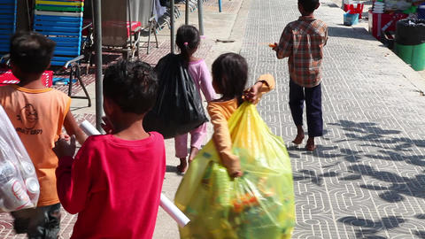 Children collect bottles in the street Footage