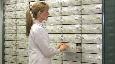 Pharmacist Searching Medicines in Shelf Footage