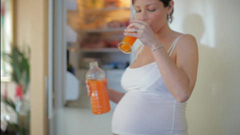 Pregnant Woman Drinking Juice Footage