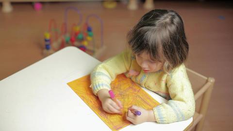 Child Drawing in preschool, little girl in kindergarten Footage