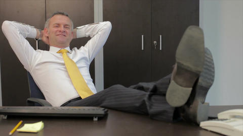 Relaxed Businessman in Office Footage