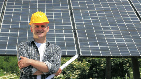 Manual Worker in industry with solar panels for clean green energy ビデオ