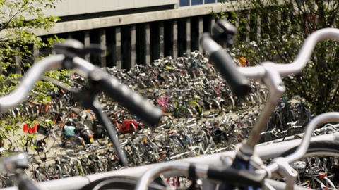 Row of Parked Bicycles in Amsterdam, Holland, The Netherlands Footage