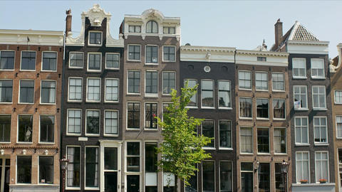 Low Angle View of Houses in Amsterdam, Holland, The Netherlands, Europe Footage