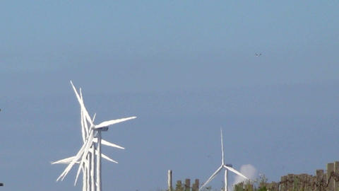 Row of wind turbines generating clean energy in th ビデオ