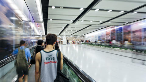 Commuters on a moving walking transiting Hong Kong Footage