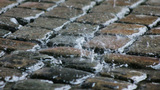 Rain Splashing On Cobble Stone Road stock footage