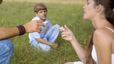 Little Boy Looking At Parents Smoking Cigarette stock footage