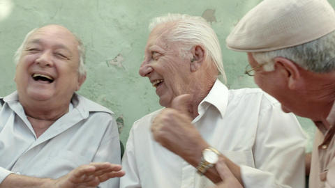Group of elderly men laughing and talking Live Action