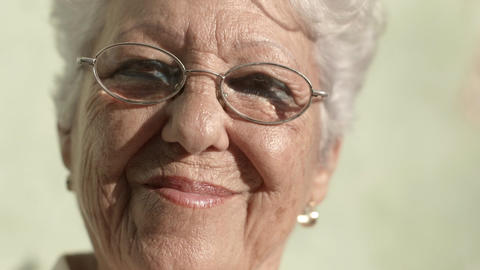 Old woman with eyeglasses smiling Footage