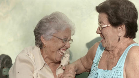 Senior female friends talking and laughing Footage
