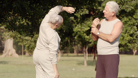 Old couple jogging and measuring blood pressure Footage