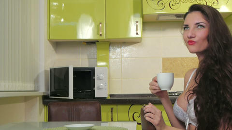 Girl In The Kitchen Drink Coffee stock footage