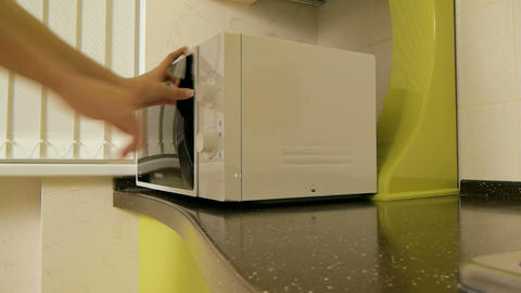 Reheating Food In The Microwave stock footage