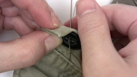 Sewing A Button Footage