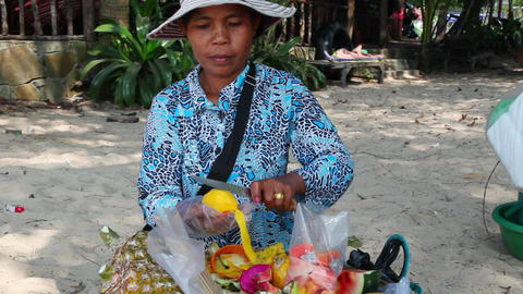 Cambodian woman cuts mango Footage