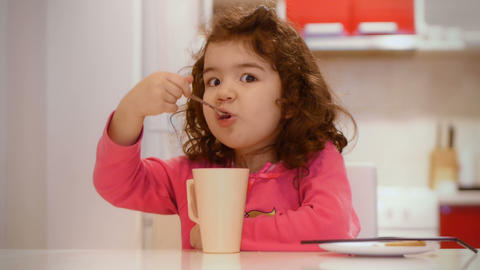 Cute Girl Learning To Eat stock footage