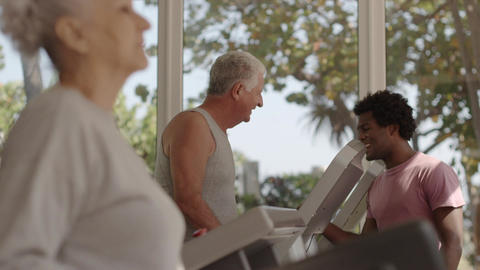 Personal Trainer Helping Senior People In Gym stock footage