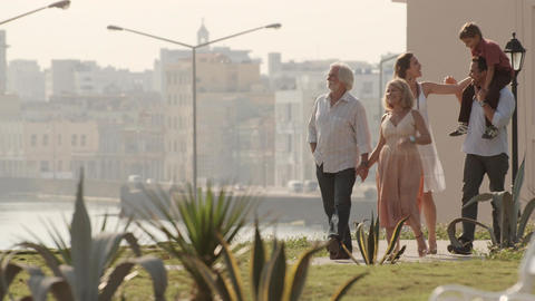 Happy Family Walking In City Park stock footage
