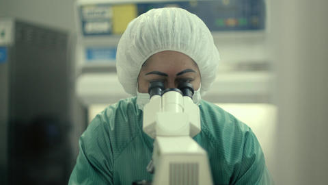 Female Researcher with Microscope Footage