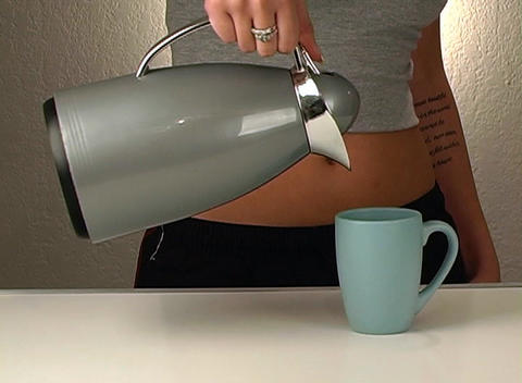 Woman Wearing Exercise Pants Pours Coffee 5 Footage