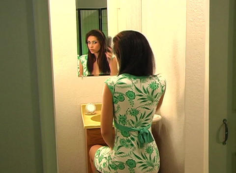 Beautiful Young Woman in Her Bathroom Brushing Her Hair 8 Stock Video Footage