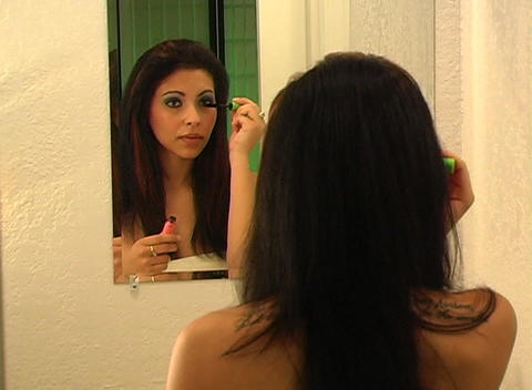 Beautiful Young Woman Applies Mascara 2 Stock Video Footage