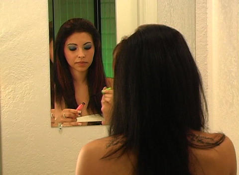 Beautiful Young Woman Applies Mascara 2 Stock Video Footage
